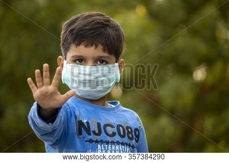 Indian Child With Mask Showing Five Fingers For Do The Five Tips Protecting From Corona Virus