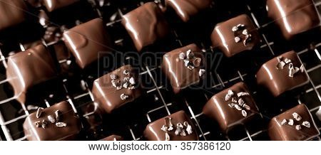 Dark Chocolate Marshmallow Pralines And Bonbons Decorated With Cocoa Nibs.