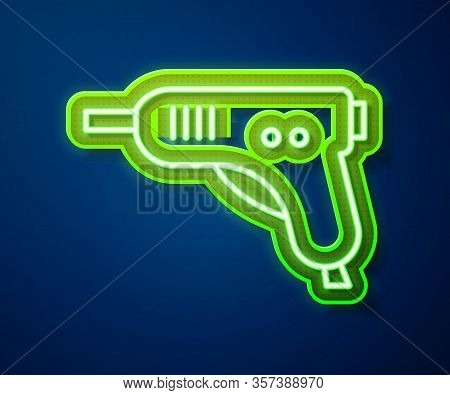 Glowing Neon Line Electric Hot Glue Gun Icon Isolated On Blue Background. Hot Pistol Glue. Hot Repai