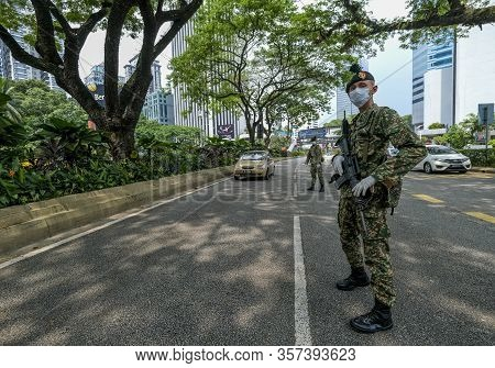 Malaysia Soldier And Police Inspect Road Users To Prevent Spread Of Covid-19