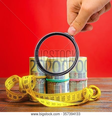 Euro Bills And Measuring Tape. The Concept Of Business And Finance. Profit And Income Analysis. Capi