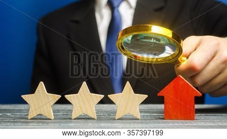 A Critic Rates A Hotel Rating. Three Stars. The Evaluation Of Visitors. Quality Level, Good Service.