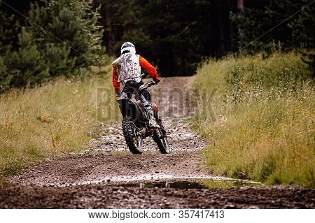 Back Enduro Racer Riding A Dirty Trail In Motocross Race