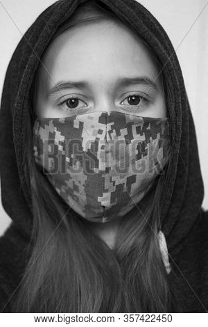 Teenager Wearing Military Face Mask. Coronavirus And Flu Epidemic Concept. Girl, Standing In A Mask.