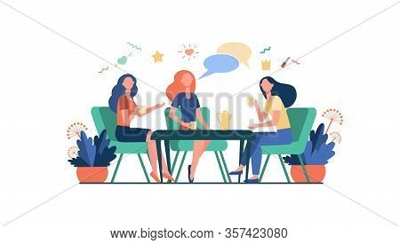 Female Friends Hanging Out In Cafe. Women Sitting At Table, Drinking Tea Or Coffee, Talking With Spe