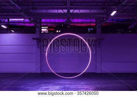 White Empty Hangar Illuminated By Neon Violet Circle, Empty Factory Interior With Roller Shutter Doo
