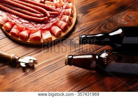 Beer Snack In The Form Of Meat Products And Bottled Beer. Appetizer In The Form Of Slicing Bacon, Sa