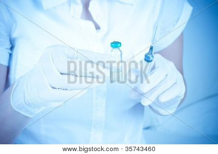 ampoule in a hand