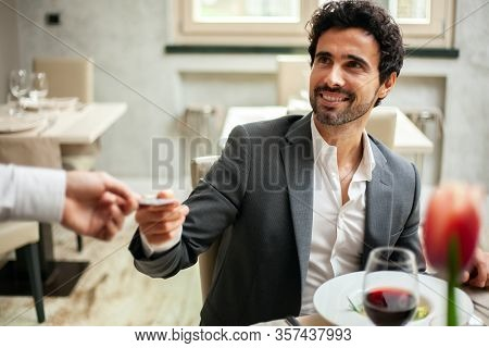 Man paying the bill with a credit card