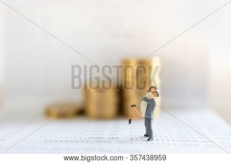 Business, Money, Saving, Security And Couple Family Concept. Close Up Of Man And Woman Miniature Fig