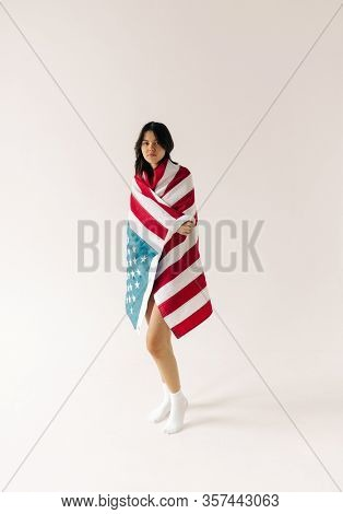young woman with us flag on the white background