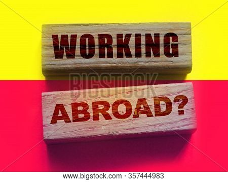Working Abroad Words On Wooden Blocks. Business Human Resourses Hr Headhunting Concept
