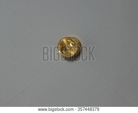 Orlando, Fl/usa-3/9/20: A Stack Of Gold Coins. Concept Money, Riches, Wealth, Banking, Finance, Lend