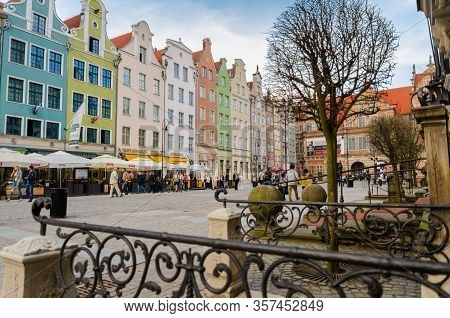 Gdansk, Poland, April 15, 2018: Facade Of Beautiful Typical Colorful Houses Buildings, Brama Zielona