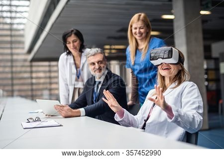 Doctors And Pharmaceutical Sales Representative Using Vr Goggles.