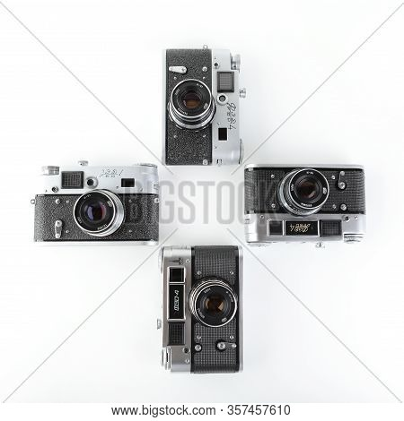 All Versions Of Old Soviet Rangefinder Film Camera Fed-4, Released 1964, 1965, 1970, 1980 On White B