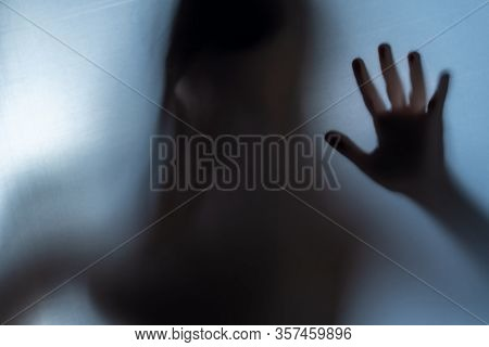 Blurred Woman's Hand Shadow Asking For Help. Horror And Domestic Violence Concept