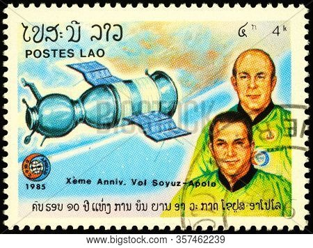 Moscow, Russia - March 22, 2020: Stamp Printed In Laos Shows Crew Of Soviet Spacecraft Soyuz-19 - Al