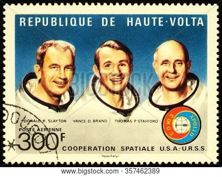 Moscow, Russia - March 22, 2020: Stamp Printed In Upper Volta Shows Crew Of Spacecraft Apollo: Donal