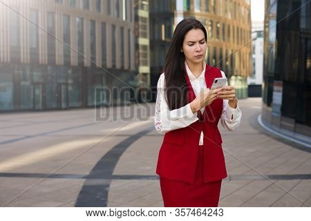Disappointed Woman Managing Director Reading Text Message On Smartphone With Bad News About Bankrupt