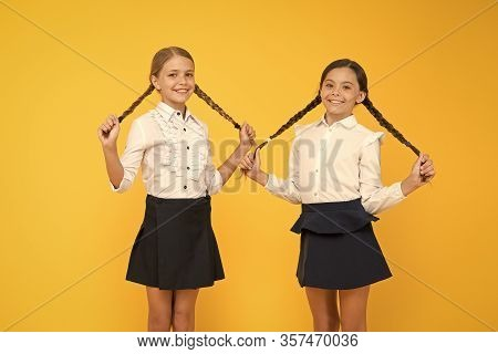 Easy Back To School Hairstyle. Cute Small Girls With Long Hairstyle On Yellow Background. Adorable L