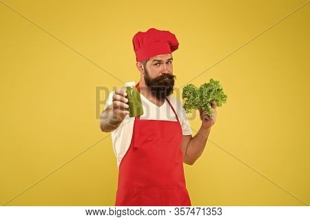 Hipster Smoothie Beverage. Concentrated Freshness. Fresh Juice. Squeezing Smoothie. Man Bearded Chef