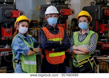 Group Of Man And Woman Workers With Mask Stand With Confident Action In The Factory Workplace And Va