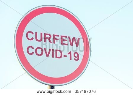 Street Sign With Curfew, Virus Covid-19. Close Up.