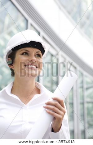 Woman Wearing A Hardhat Holding Plans