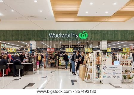 Adelaide, Australia - August 17, 2019: Woolworth Entrance With Customers Viewed  From Inside Of Unle