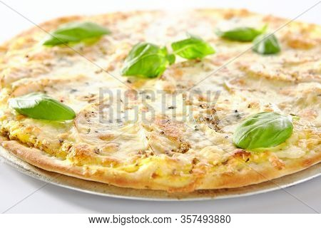 Sweet dessert pizza bianca or brazilian pizza with pear, nuts and gorgonzola cheese on metal tray isolated. Alternative italian fruit flatbread cutout, ready for menu design