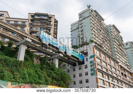 Chongqing, China - Sep 4, 2019: Train Arriving At The Liziba Station In Chongqing. The Station Is A