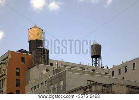 Water Tanks On Top Of Buildings Roof Tops In New York City.