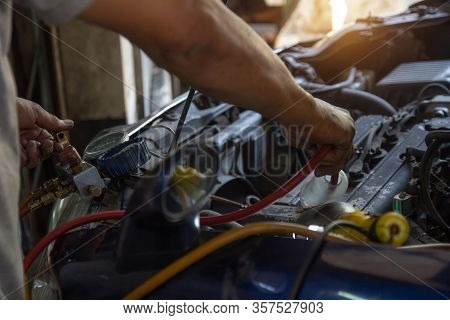 Technician Maintenance, Cleaning Car Heating Ventilated And Air Conditioning (hvac) In Engine Room.