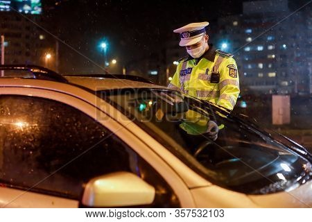 Bucharest, Romania - March 23, 2020: Police Check Out Drivers And Their Papers During The Curfew In