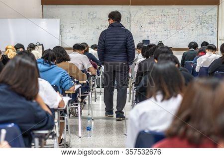 Bangkok, Thailand - December 6, 2019: School Exam Room With Teacher (invigilator) Monitoring Student