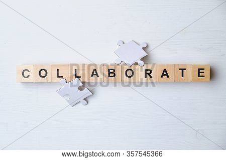Modern Business Buzzword - Collaborate. Top View Puzzle, Wooden Blocks. Close Up. Top View.