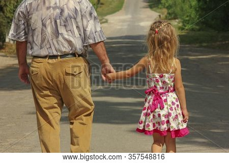 Grandfather With The Happy Grandson Go On The Road
