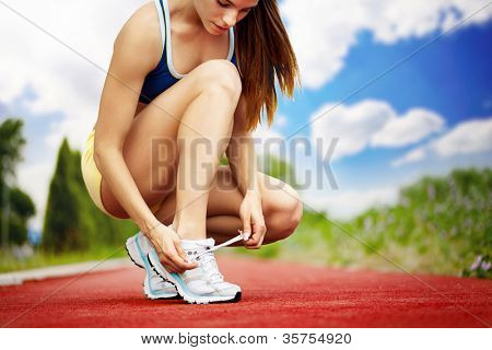 Athlete girl trying running shoes getting ready for jogging