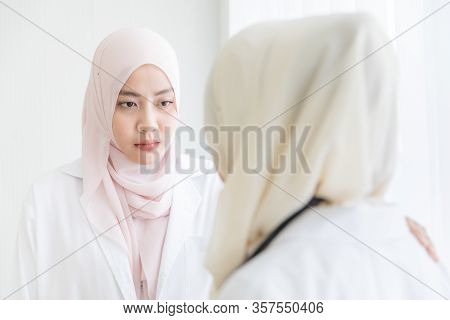 Female Muslim Doctor In Hijab Dress Feels Sad From Failure And Her Friend Try To Soothe And Encourag