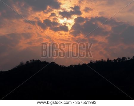 Bright Sunrise In The Mountains.sunset Through Tree Branches. Nature Background.silhouette.beautiful