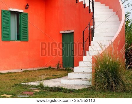 Vintage Style Building.the Window And Door On The Wall With Curved Stairs In The Datyime.