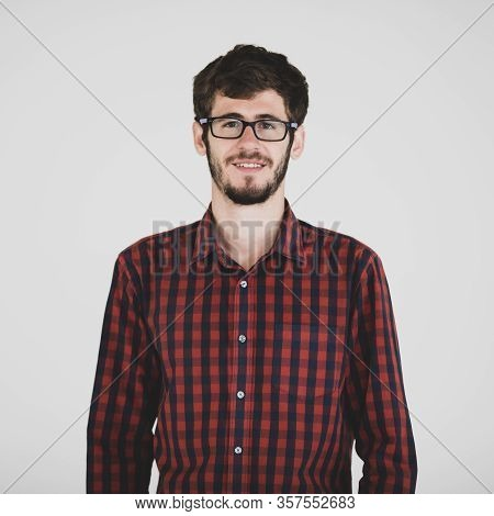 Portrait Of Young And Handsome Friendly Face Man Wearing Eyeglasses Standing On Grey Background With