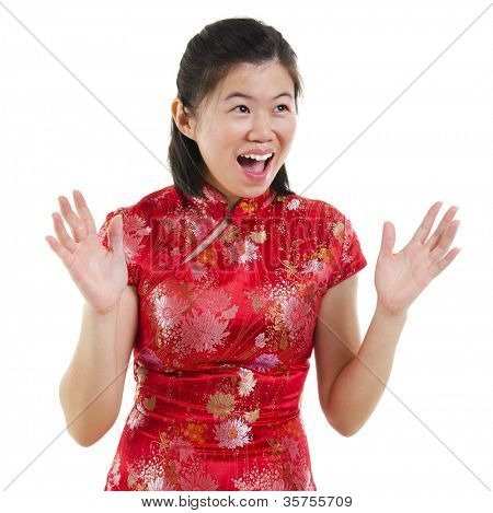 Happy oriental woman open her arms with surprising face over white background
