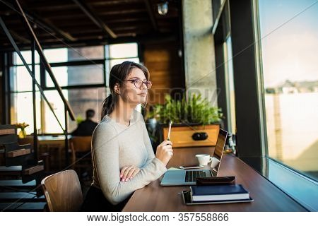 Thoughtful Woman Professional Web Content Writer Or Publication Specialist Thinking About New Work I