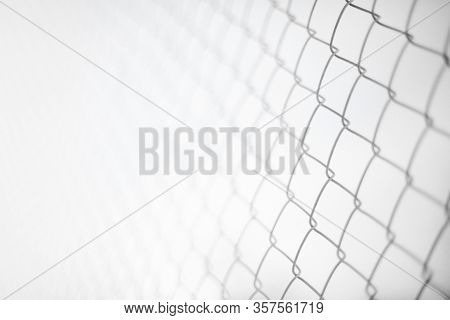Close Up Rusty Wire Fence And Blurred Nature Background. Wire Netting Or Metal Fence Net And Out Of