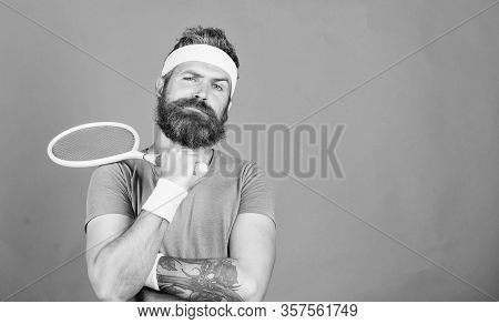 Tennis Sport And Entertainment. Concentrated On Tennis Court. Athlete Hipster Hold Tennis Racket In