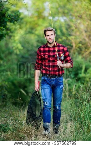 Big Game Fishing. Fisher Hold Fish Net. Hobby. Man Checkered Shirt On Ranch. Fisherman With Fishing