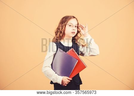 Check Knowledge. Final Exam Coming. Girl Hold Textbook Folder Test. School Exam Concept. Prepare For