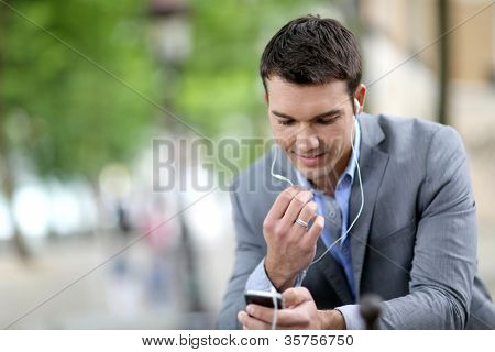 Businessman in the street talking on the phone
